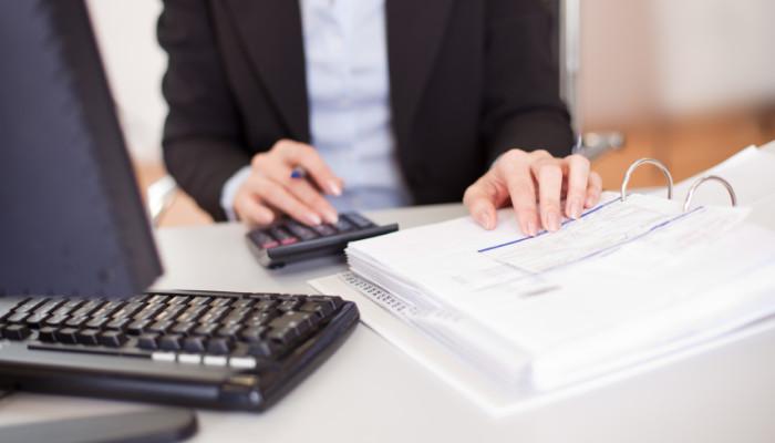Closeup of a businesswoman doing finances